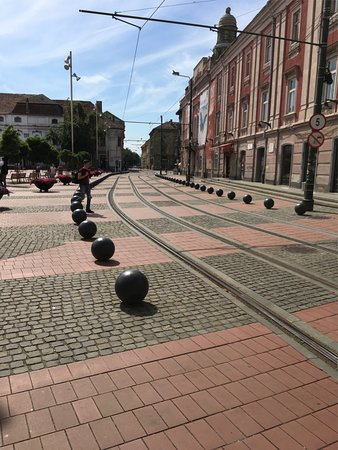 Libertatii Square: Tramlines in Piata Libertatii showing the black and red mosaic