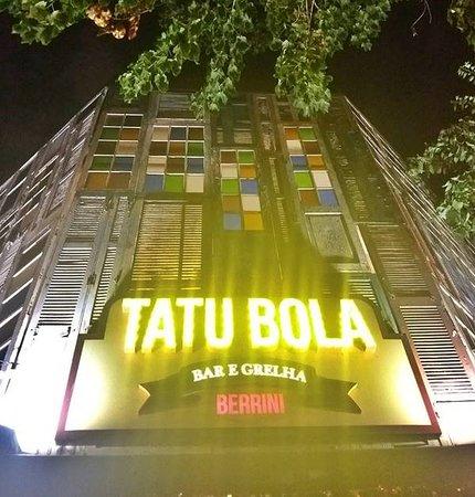 Tatu Bola Berrini: The neon sign at the bar's entrance