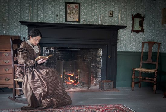 Girl reading by the fireplace