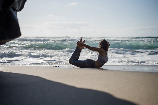 Bow pose by Island Yoga Fuerteventura at the beach