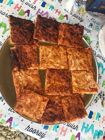 Tega Cay, SC: Premade frozen pizza squares served burnt for just $8