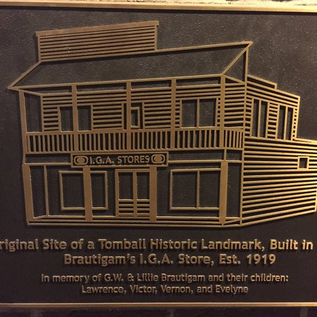 Historical Plaque on the front of the building at Main Street Crossing