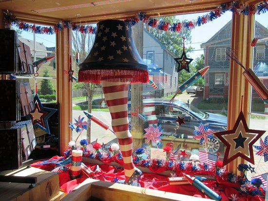 a christmas story house display in the window of the gift shop