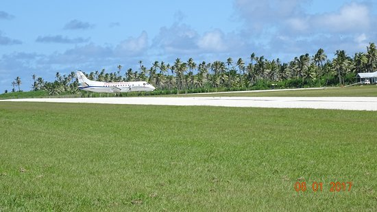 Sandy Beach Resort: View from road crossing to our plane (just landed) and local airport hanger