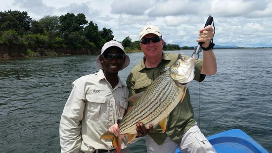 Tiger Safaris: Alex and his client with his happy catch.
