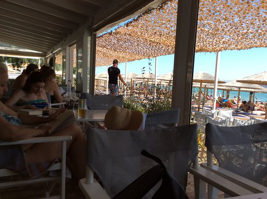 East Attica Region, Griekenland: Delfini year round beach restaurant ...new look. New style. Old fashioned welcome
