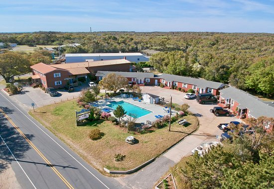 Aerial view of the Cape Pines Motel;  Cape Hatteras Lighthouse and Beach are in the background.