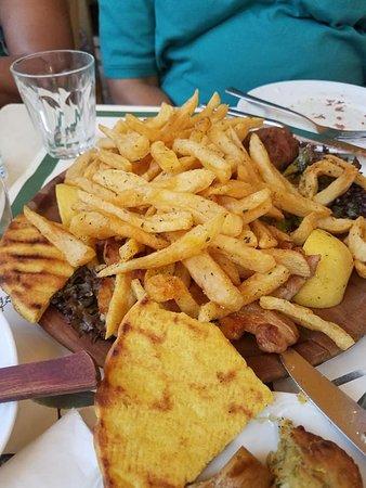 Grilled mix meats under potato fries (beef, chicken, pork, sausage)