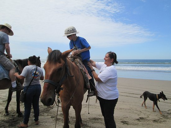 Isla de la Piedra, México: Sophie helping my son on his horse.