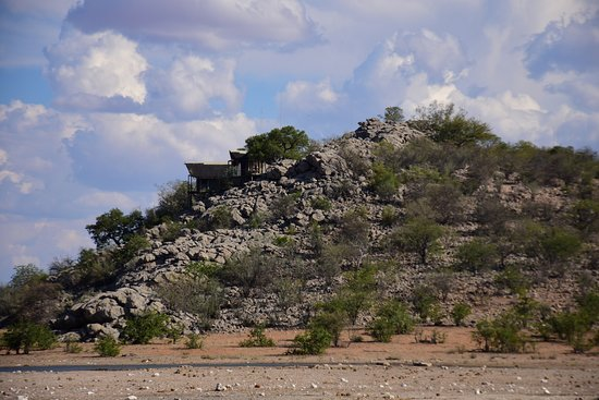 Dolomite Camp: View of Dolomite hill from adjacent waterhole.
