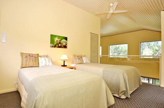 Tree-Elle Retreat: Tree Elle Retreat Lofthouse upstairs twin bedroom