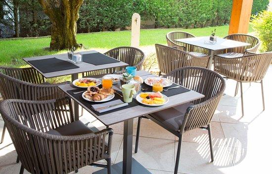Best Western Hotel Turismo: sala esterna per colazioni, giardino