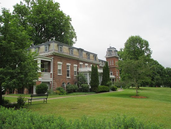 Oneida, NY: The outside of the mansion with its beautiful lawn and majestic old trees