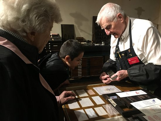 Grand Rapids Public Museum: Craftsman in print shop demonstrating how print used to be set