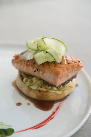 Salmon burger with avocado, soy sauce and marinated cucumber