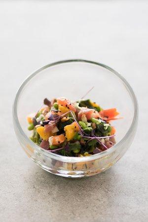 Seafood salad with soy sauce, edamame, peanuts, wakame, orange segments, onion and sesame