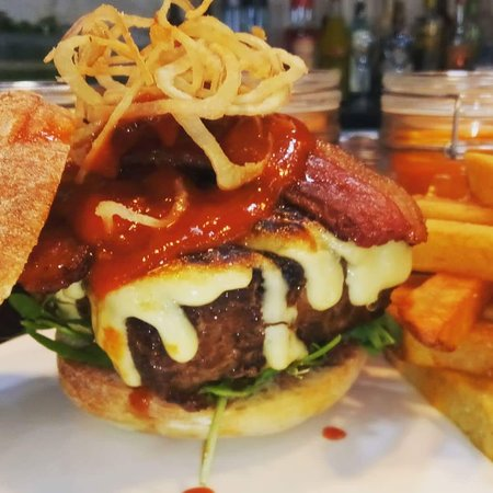 Osher Bar & Grill: Our BBQ burger with Beef Bacon, BBQ Sauce, Garlic Aioli, Crispy Shallots.