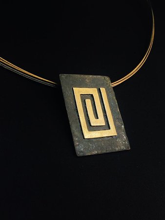 Elements Handmade Jewels: A Rhodium black hammered meander neckless, made from 925 Silver and plated partial with 24k Gold