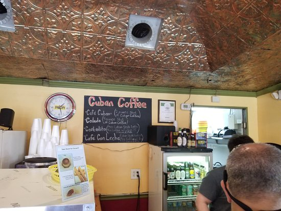 Hola! Cuban Cafe: certificate of Excellent from Tripadvisor. You can see the employee