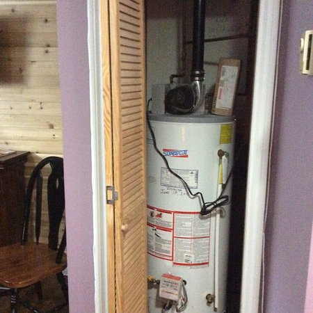 """Inn on Bennett: The basement """"room"""" - water heater for the building is in room. Bathroom does not have a door -"""