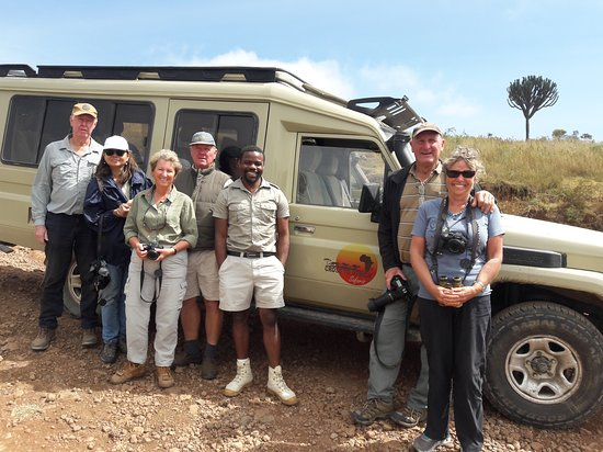 Cross to Africa Safaris: Our driver guide along with our clients just before game drive in Ngorongoro crater