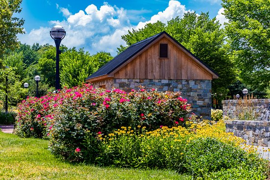 Carroll Creek Linear Park: One of the historic stone buildings and flower gardens