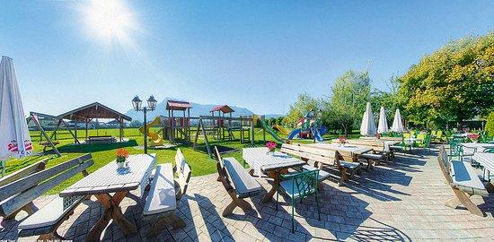 Wals, Austria: Kinderspielplatz -  im Blickfeld der Eltern