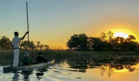 Sanctuary Stanley's Camp: An evening sunset viewed from a Makoro (traditional dug-out canoe)