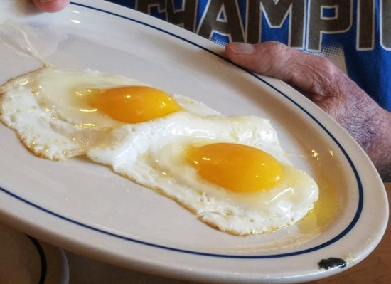 Lansing, KS: Second set of undercooked eggs and dirty plate.