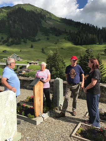 Erwin Tours of Switzerland - Day Tours: My family chatting with a distant relative at the St. Antonien protestant church and cemetery.