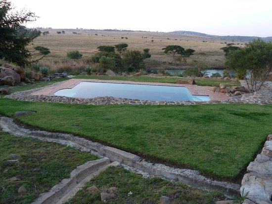 View across pool, river, and historic Rorke's Drift.