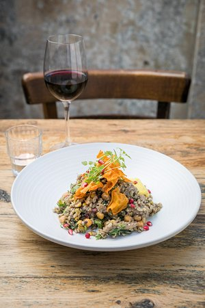 Warm braised lamb and barley salad with pomegranite