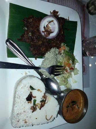 no more words...taste of puttu & poricha chiken. super presentation