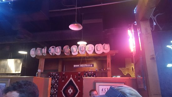 Lytle Land and Cattle Company: Hats from previous employees decorate the walls
