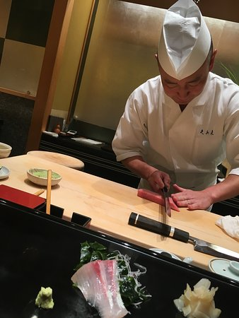 "Kyubey Ginza Honten: Our sushi chef cutting sashimi, My ""plate"" is what you see at the bottom of the screen"