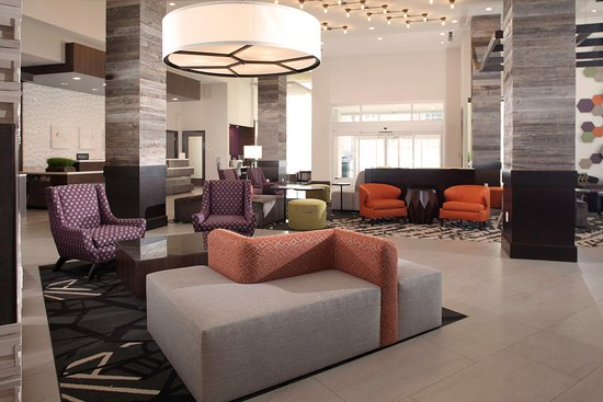 Hilton Garden Inn Charlotte Waverly: Spacious lobby with modern design provides and inviting space for guests to converse