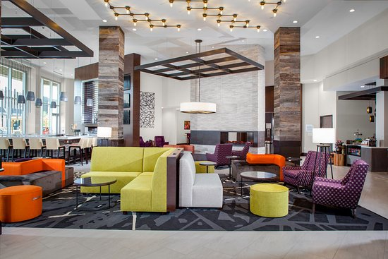 Hilton Garden Inn Charlotte Waverly: Our modern lobby is appointed with technology infused décor with outlets in unconventional place