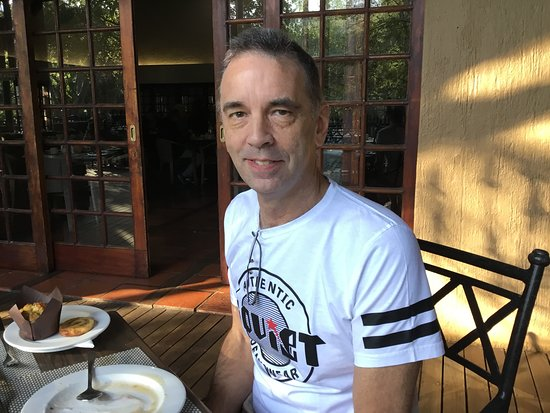 Skukuza, South Africa: At breakfast. My husband MICHAEL. Sitting outside, it's cold. Rather sit inside.