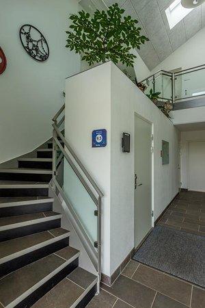 Naturperlen: Entre med med adgang til lejligheder, værelser og reception