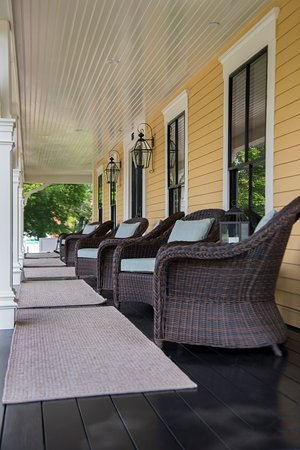 Wolfeboro, NH: The expansive front porch is a favorite spot for relaxing