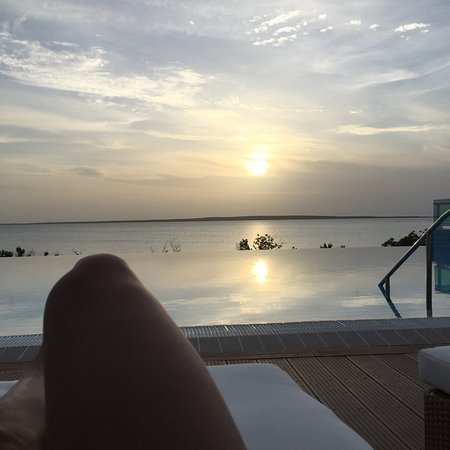 Cayo Las Brujas, Cuba: From the long chair watching the sun set in front of the infinity pool and sea in the background