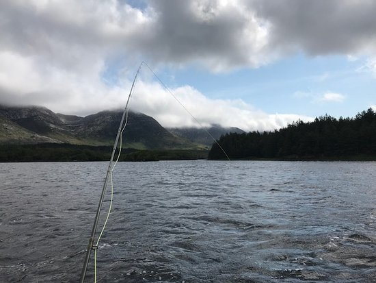 Lough Inagh Lodge: Fishing leeward from a beautiful boat.