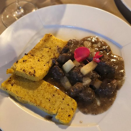 Arba, Italy: Wild boar with pear and polenta.