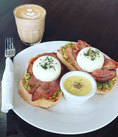 Brisbane Region, Australia: Smashed avocado on sourdough with bacon and poached eggs