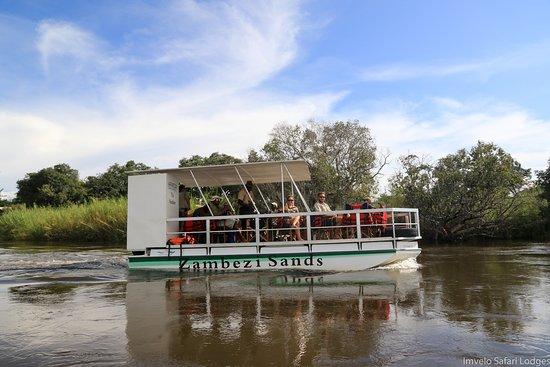 Zambezi National Park, Simbabwe: The Nembwe Catamaran cruiser at Zambezi Sands.