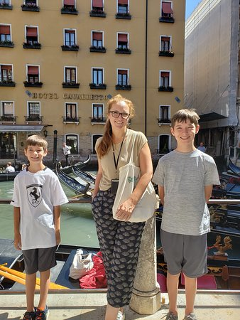 LivItaly Tours: Marie-Therese, our guide in Venice, with our sons. Waiting for the gondola ride!