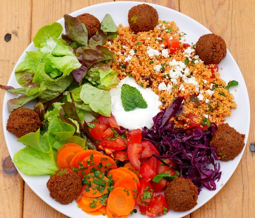 Veggie Bros: Falafel plate with salads, couscous and joghurt-mint-dip