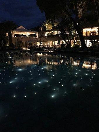 Kontokali Bay Resort and Spa: Pool and hotel at night.