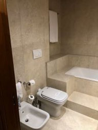 Steps to tub and reach for bath towel. - Picture of Barocco Hotel ...