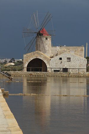 Province of Trapani, Italy: Museum - Trapani Salt Pans with a storm approaching
